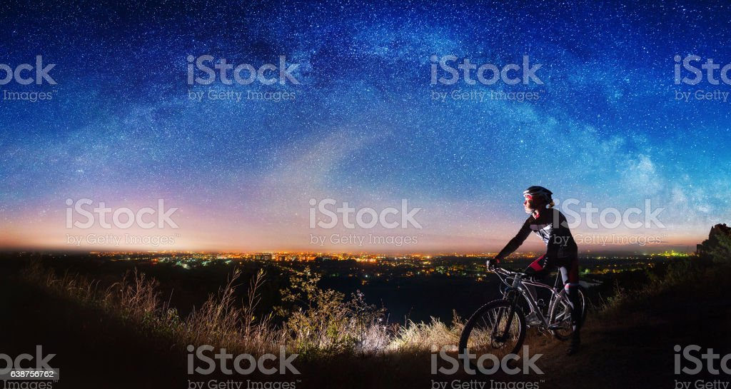 Bicyclist with mountain bike on top of the hill stock photo