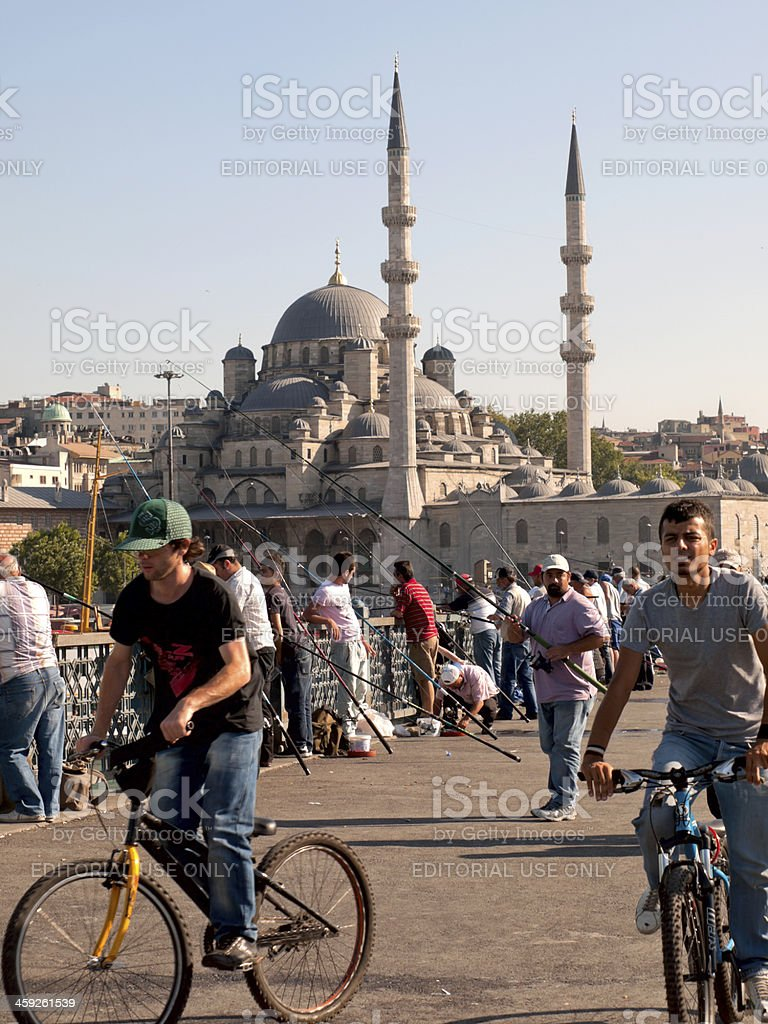 bicyclists at Galata Bridge in Istanbul stock photo