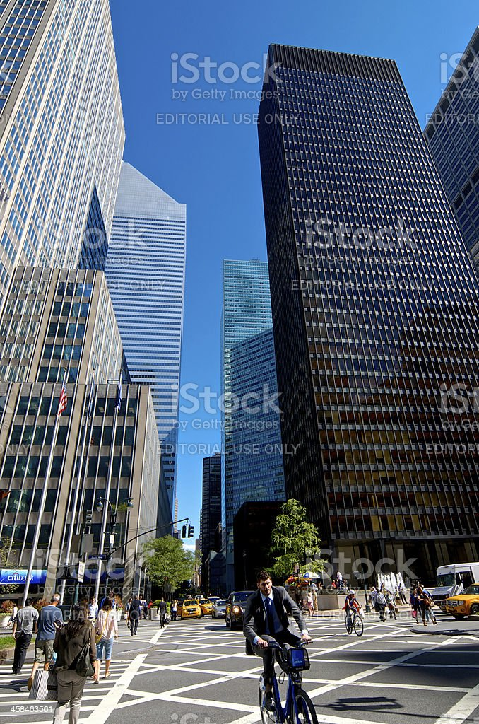 Bicyclists & Midtown Manhattan Architecture Cityscape, New York City royalty-free stock photo