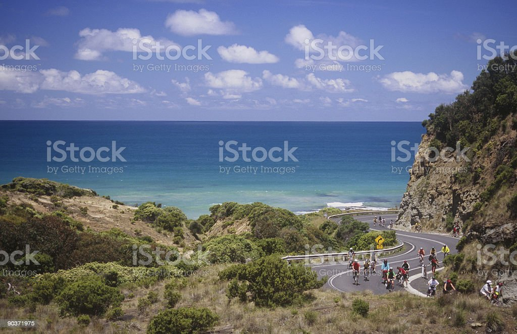 Bicyclists on great ocean road stock photo
