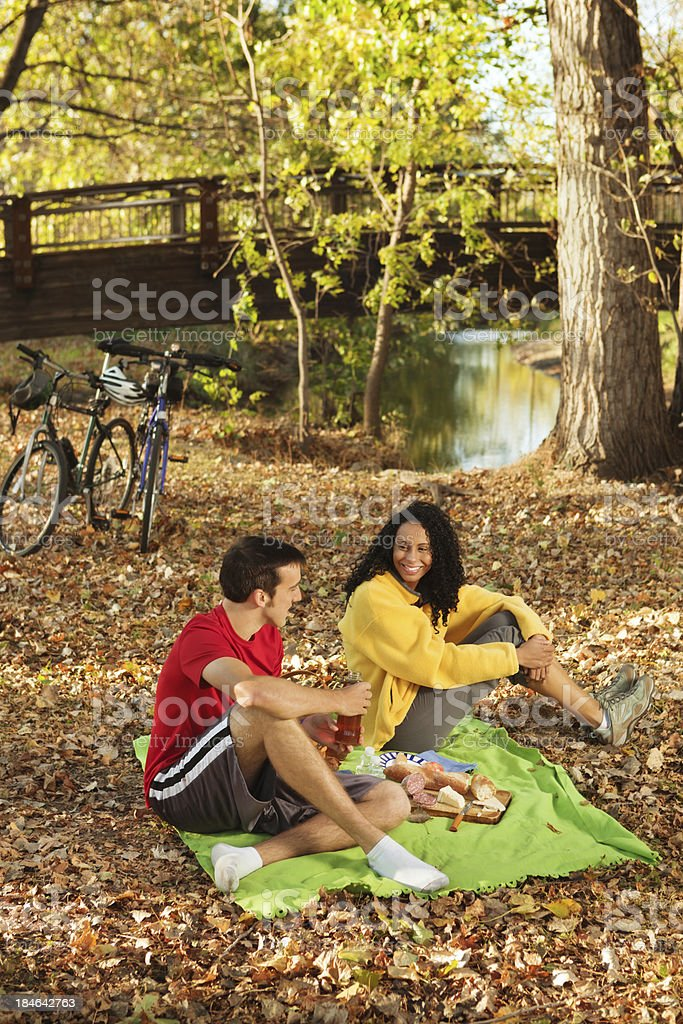Bicyclists Resting and Picniking along a Creek in Autumn Color royalty-free stock photo