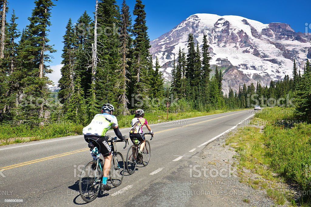 Bicyclists Touring Mount Rainier National Park, Washington stock photo