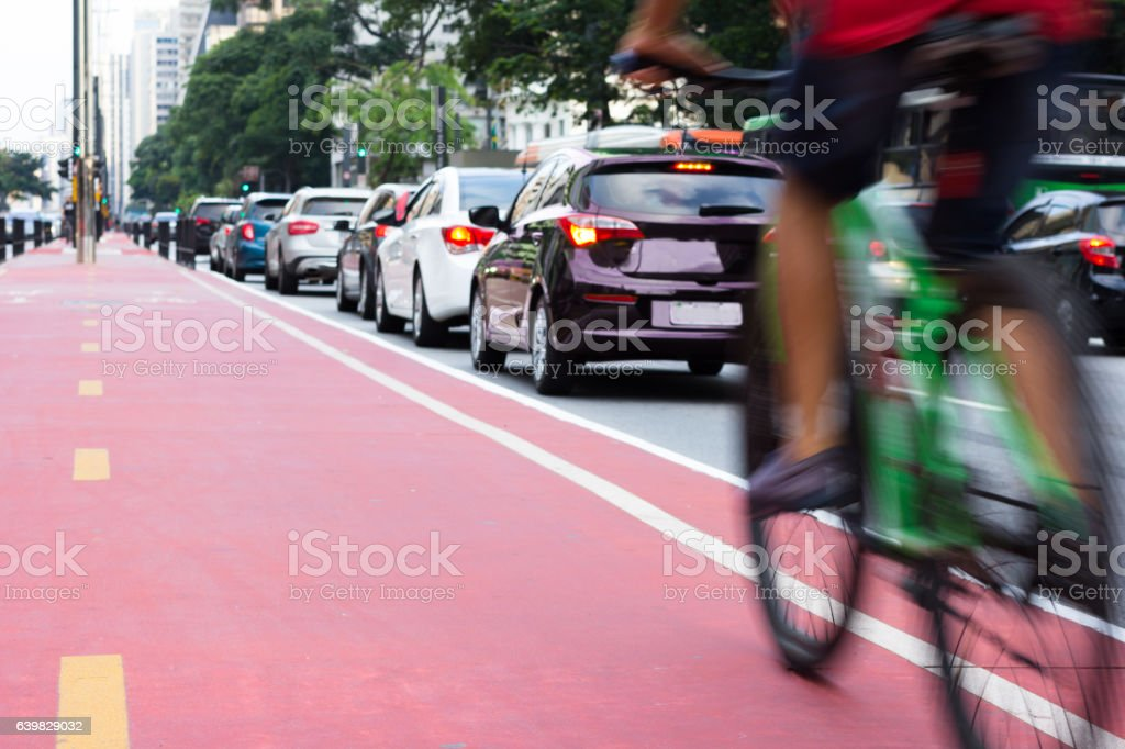 Bicyle and cars in downtown area stock photo