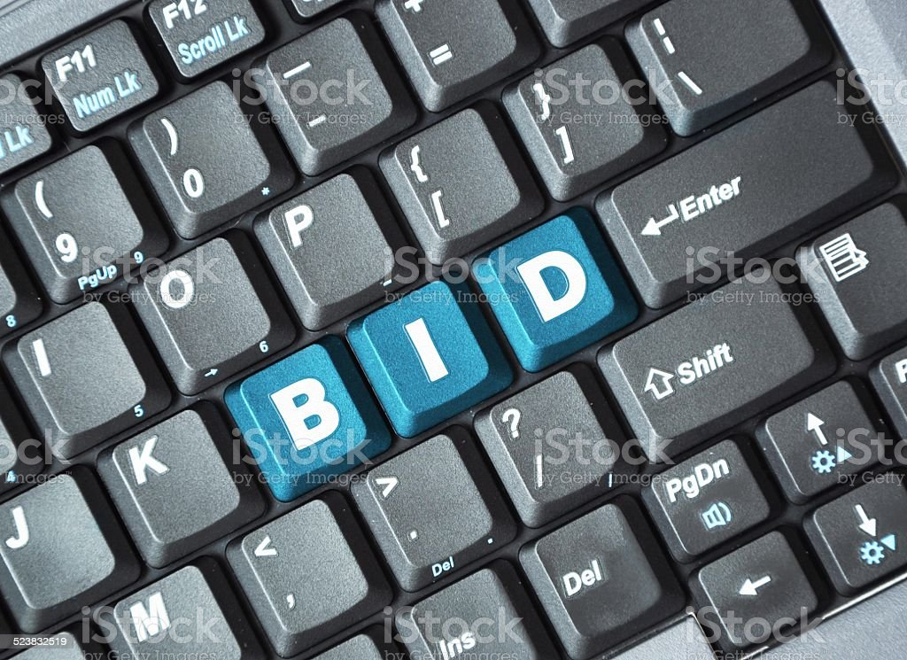 Bid key on keyboard stock photo