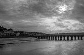 istock Bideford, on the River Torridge in North Devon, on a bad weather, rainy day in winter. Monochrome. 1298966957