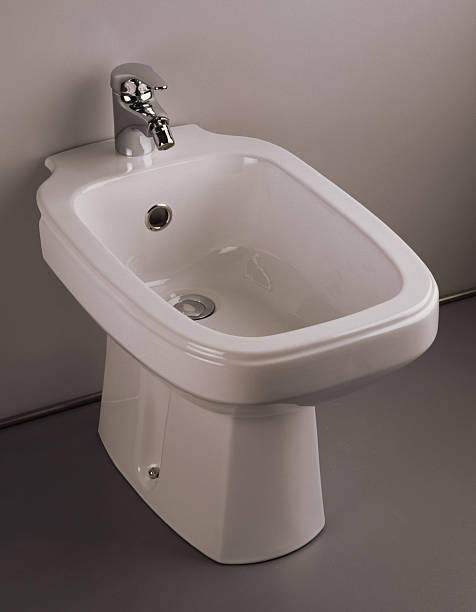 bidet A bidet and its faucet as one product grifare stock pictures, royalty-free photos & images