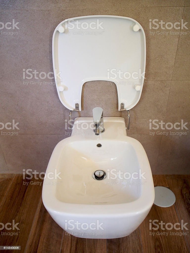 Bidet with lid stock photo