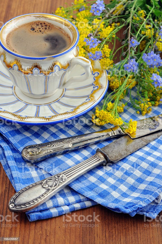 Biedermeier porcelain cup with old table knife royalty-free stock photo