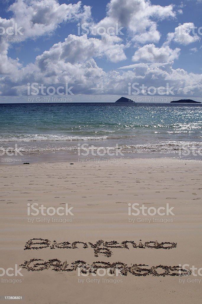 Bienvenido a Galapagos Written on Sand Beach stock photo