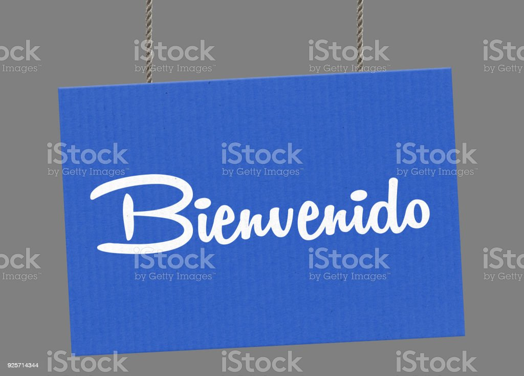 Bienvenido sign hanging from ropes. Clipping path included so you can put your own background. stock photo