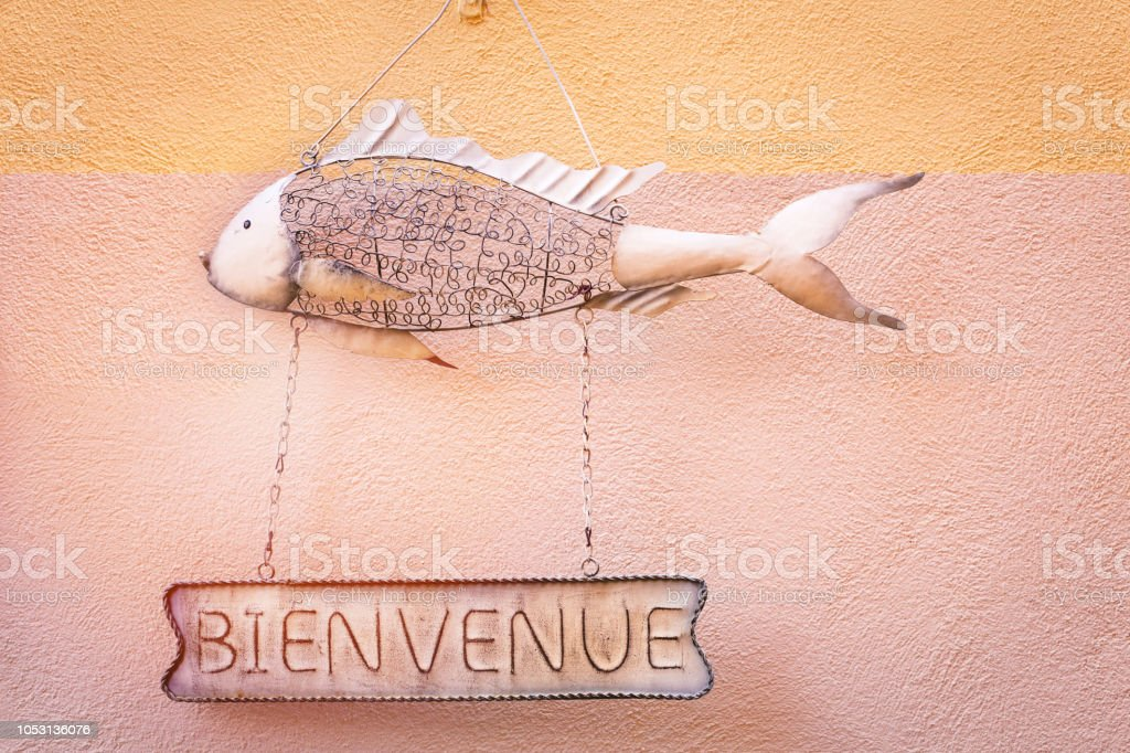 Bienvenue, Welcome on metal hanging sign stock photo