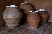 Big ancient roman amphora, indoor interior decoration