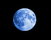 Big and beautiful blue moon stock photo