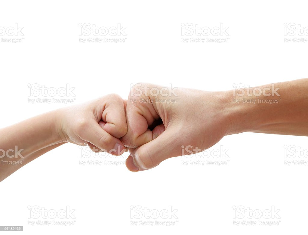 big and little hands as fists together royalty-free stock photo