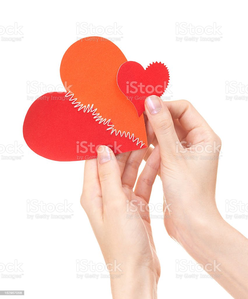 Big and small broken hearts in woman's hands royalty-free stock photo
