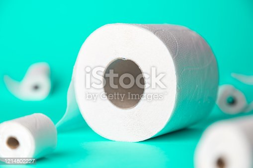 1136804881 istock photo Big and small toilet papers on turquoise background. New Corona virus infection(novel corona virus disease) background. Pandemic panic concept. 1214802227