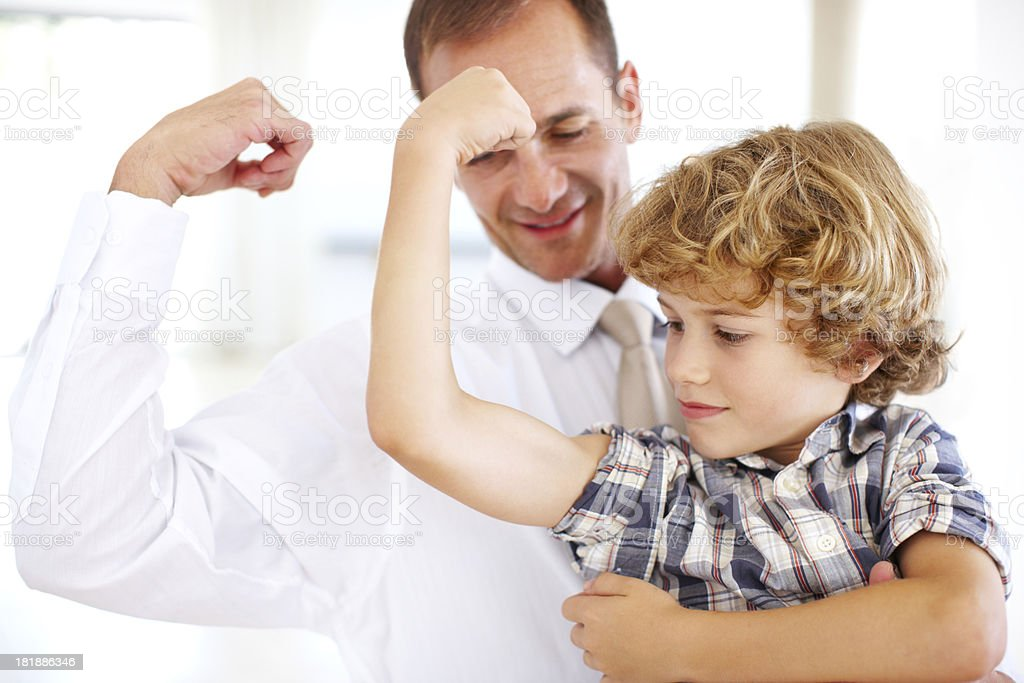 Big and strong like dad! royalty-free stock photo