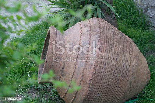 106415613istockphoto big antique clay pot or traditional Jar on abandoned hut .Ancient Greek amphora 1146900301