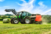 istock Big baler with film wrapper in use for grass silage preparation 1257398248