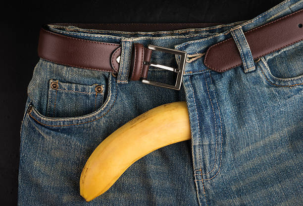 Big Banana and men's jeans, like the penis stock photo