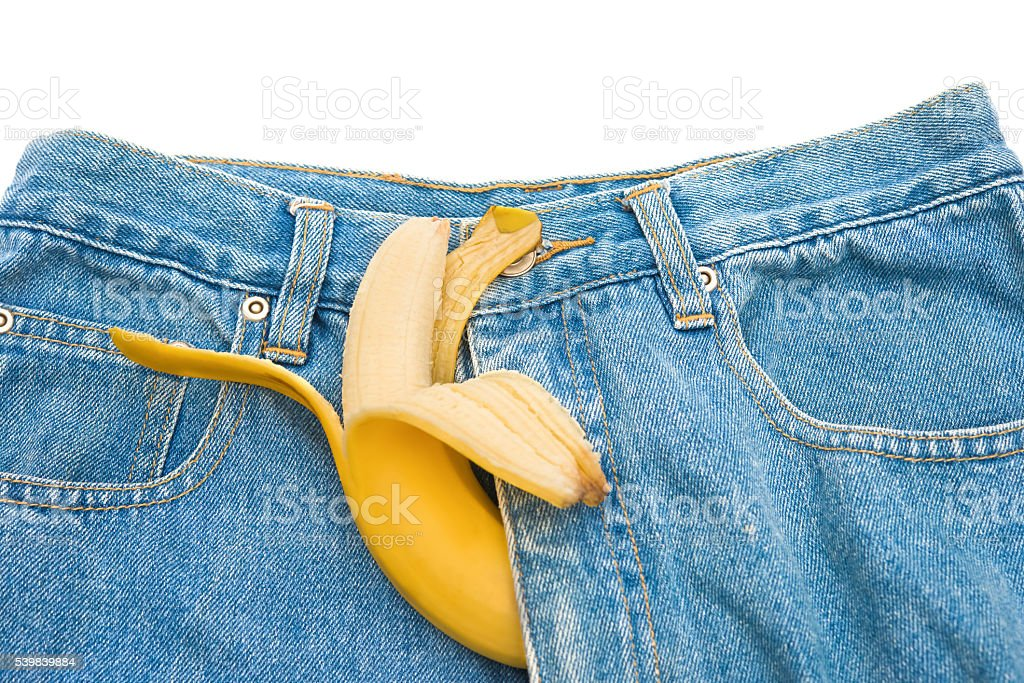 big banana sticks out of mens jeans  as potency concept stock photo