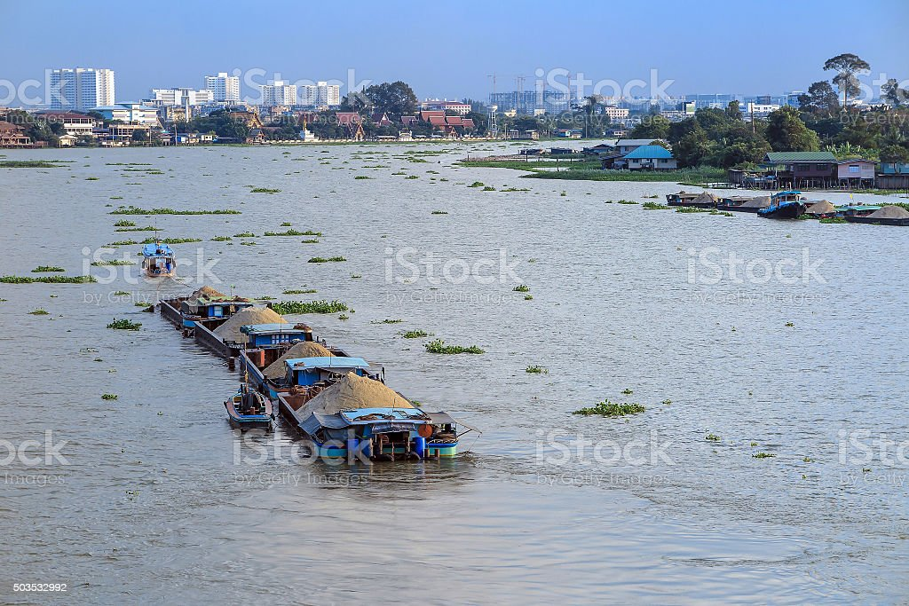 Big barge carry sand in river stock photo