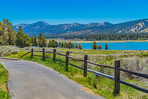 Big Bear Lake in the San Bernardino National Forest, CA A walkway and split rail fence fills the foreground leading back to Big Bear Lake in the San Bernardino National Forest, California san bernardino california stock pictures, royalty-free photos & images