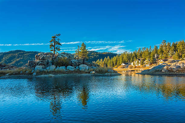 Big Bear Lake's Boulder Bay, San Bernardino National Forest, CA Reflections in the waters of Big Bear Lake at Boulder Bay fill the foreground leading back to vacations houses and the mountain ridges beyond, Southern California san bernardino california stock pictures, royalty-free photos & images