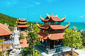 sunny day, a large beautiful temple in Vietnam, Phu Quoc island. many statues and beautiful temples.