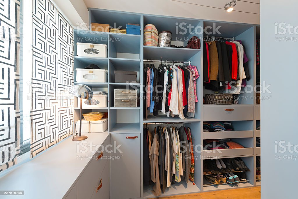Big beautiful walk in wardrobe. Luxury modern home stock photo