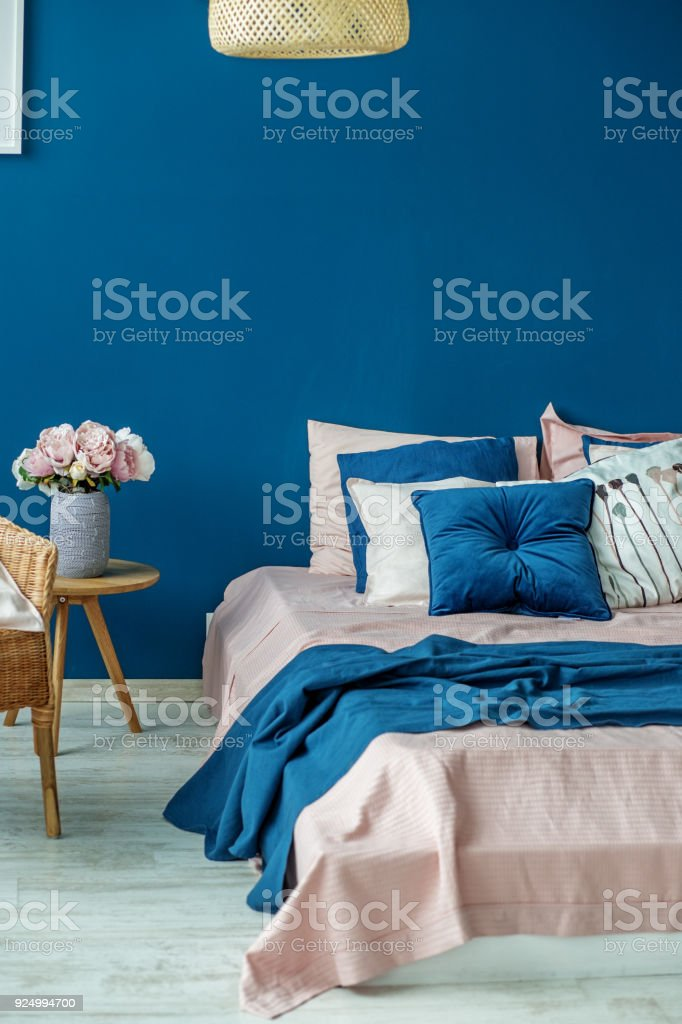 Big bed in the blue room. Concept interior, room, home, bedroom. stock photo