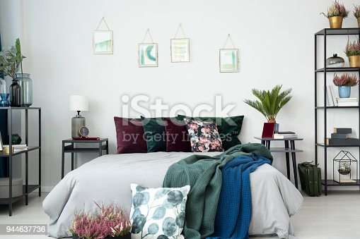istock Big bed with cushions 944637736