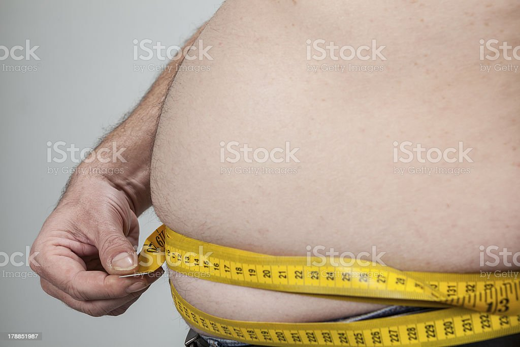 big belly of a fat man royalty-free stock photo