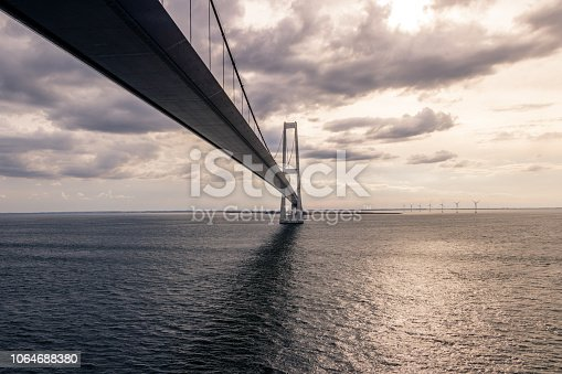 istock Big Belt Bridge from Funen to Sealand on a cloudy tranquil afternoon.Taken from the Color Line Fantasy which is a cruise ferry between Kiel and Oslo. 1064688380