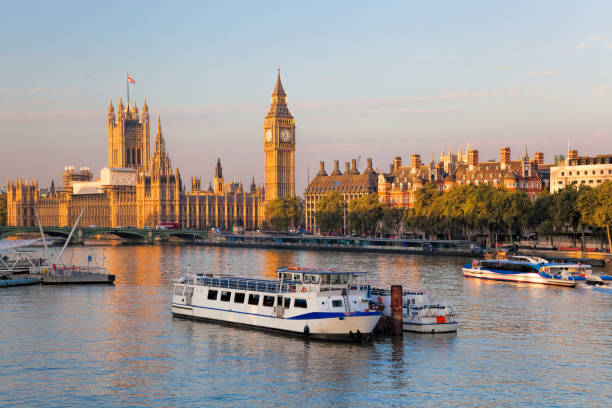 Big Ben and Houses of Parliament with boat in London, England, UK stock photo