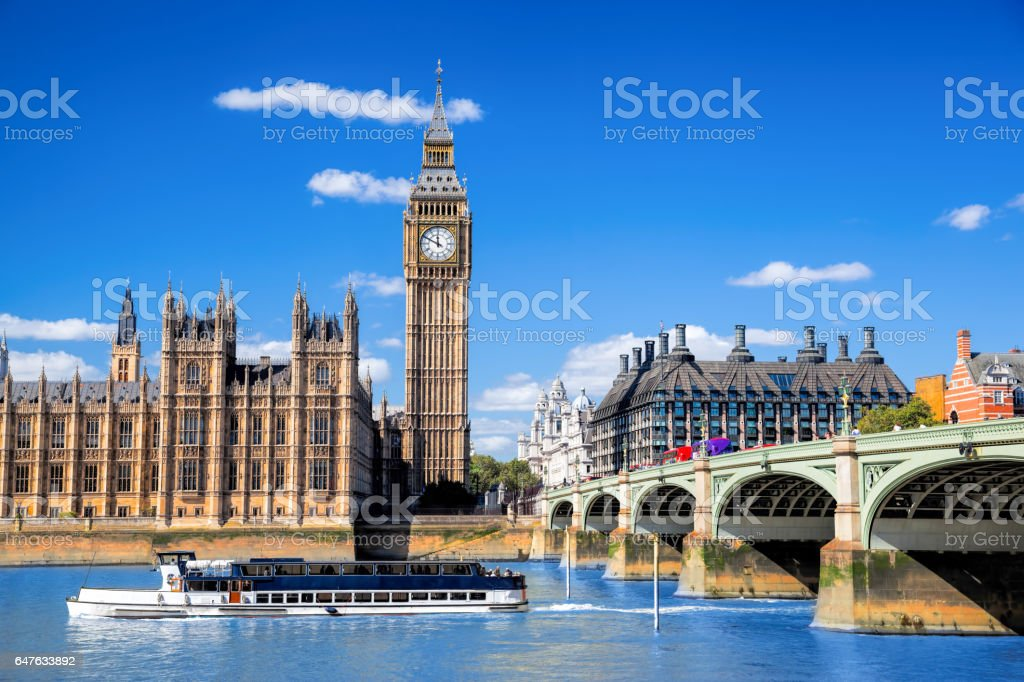 Big Ben and Houses of Parliament with boat in London, UK stock photo