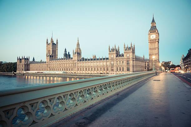 big ben and parliament building at dawn - big ben stock photos and pictures