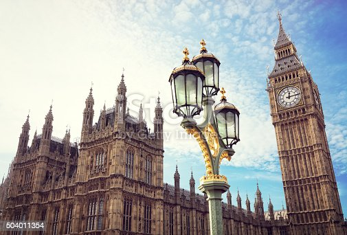 Big Ben in London with the houses of parliament and ornate street lamp