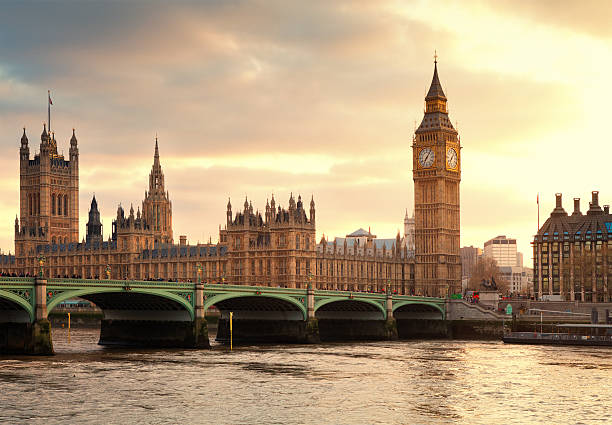big ben and the parliament in london at sunset - big ben stock photos and pictures