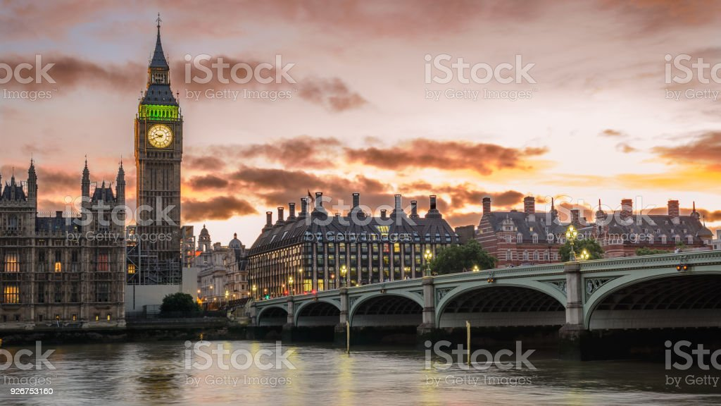 Big Ben and the Westminster Bridge at sunset in London (UK). stock photo