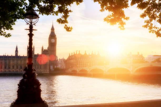 Big Ben and Westminster Bridge at sunset stock photo