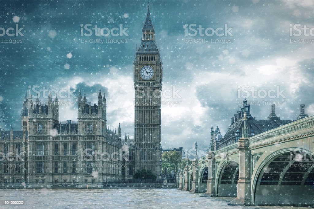 Big Ben and Westminster Bridge on a cold, snowy winter day stock photo