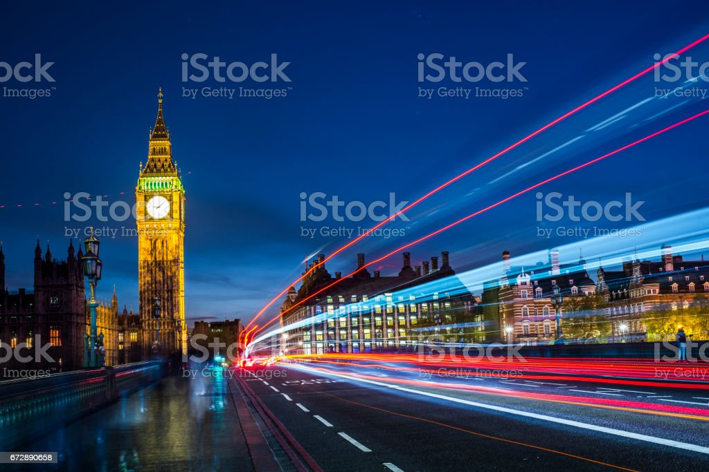 Big Ben at night with car light trails stock photo