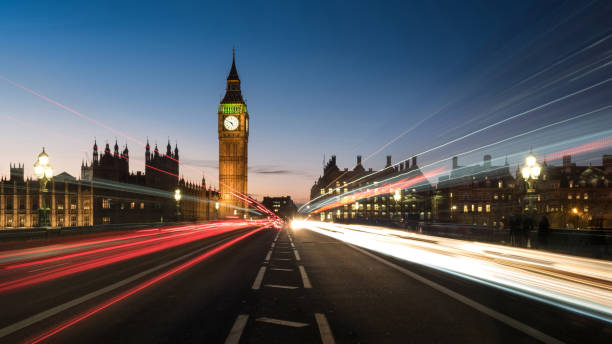 Big Ben from the Road with Light Trails Big Ben, one of London landmarks, taken on the middle of the Road with Light trails at Twilight city of westminster london stock pictures, royalty-free photos & images