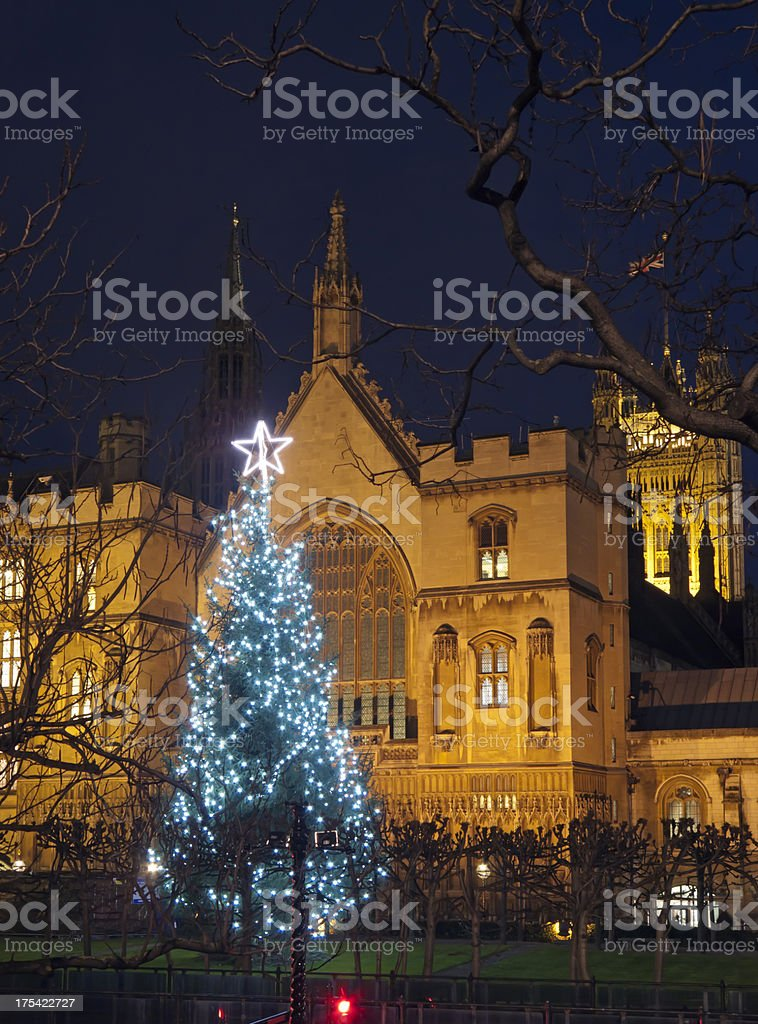 Big Ben in London with Christmas tree at dusk royalty-free stock photo