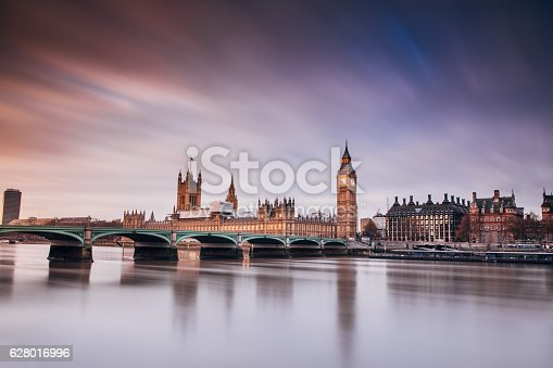 Big Ben London Westminster in morning with red sunrise sky
