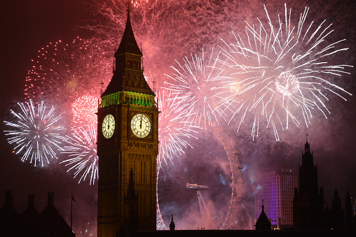 Spectacular Fireworks surround Big Ben at midnight on New Years Eve