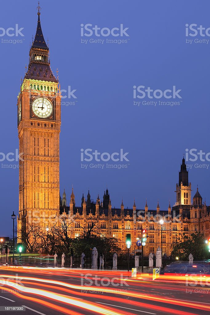Big Ben surrounded by moving cars at night royalty-free stock photo