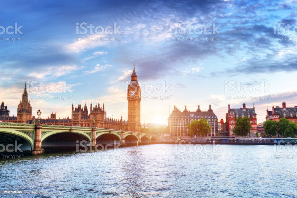 Big Ben, Westminster Bridge on River Thames in London, the UK at sunset stock photo