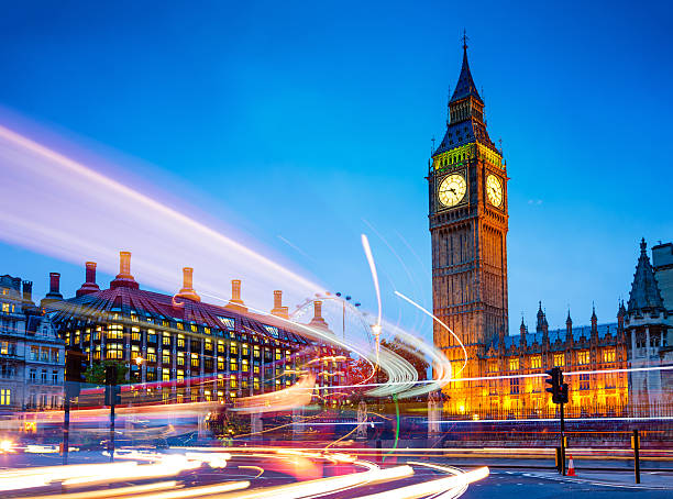 Big Ben, Westminster, London, UK Traffic light trails near Big Ben and the Houses of Parliament in background at dusk, Westminster, London, UK.  city of westminster london stock pictures, royalty-free photos & images